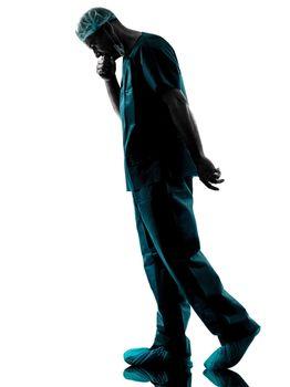 doctor surgeon man despair fatigue tired  silhouette