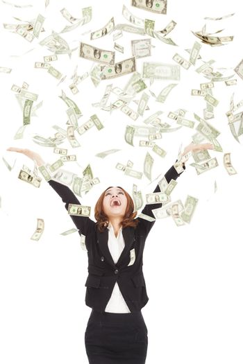 happy businesswoman try to catch the money