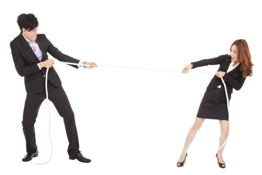 businessman and woman playing tug of  war
