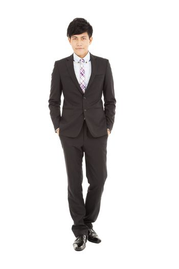 Full length of  young businessman standing