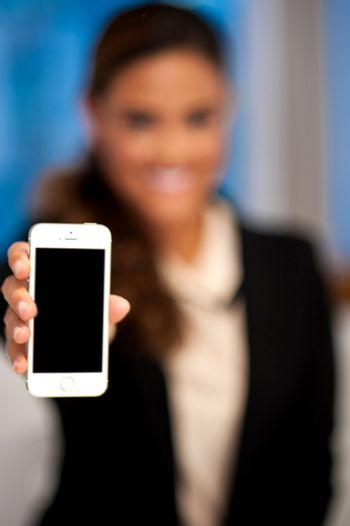 Saleswoman displaying newly launched mobile