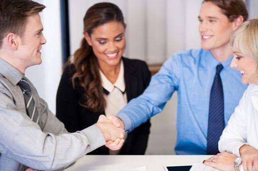 Corporate guys shaking hands