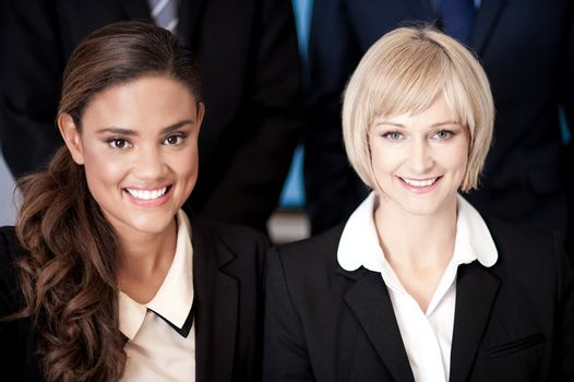 Smiling female executives at office