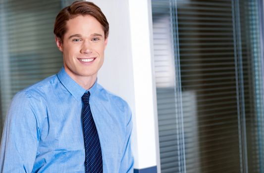 Young smiling relaxed corporate guy