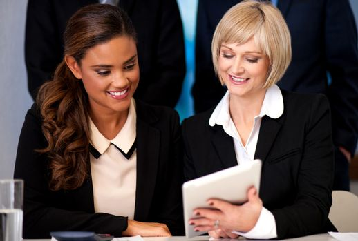 Business women browsing on tablet device