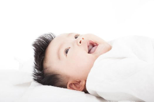 Baby having laughing and lying  on the towel