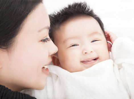 happy asian Mother and daughter or son smiling together