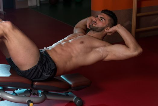 Exercising Abdominals In Fitness Club