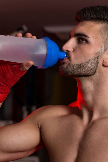 Fighter Drinking From A Bottle Of Water