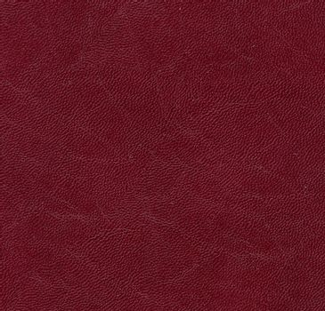 Blank sheet of brown or dark red leatherette useful as a background