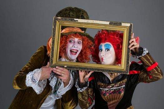 Characters from wonderland crazy hatter and red queen with a frame