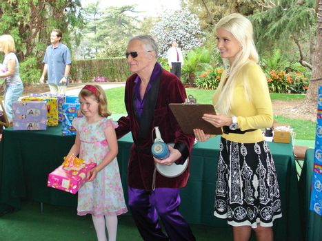 Hugh Hefner and Holly Madison at the Playboy Mansion Easter Egg Hunt. Playboy Mansion, Los Angeles, CA. 04-07-07