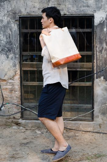 Man with canvas bag
