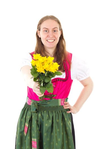 Happy woman in dirndl giving you roses as present