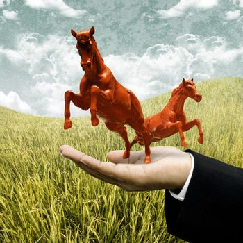 Animal farm business concept, Investor carry red horse on filed