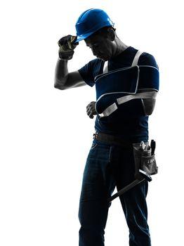 injured manual worker man with injury brace despair silhouette