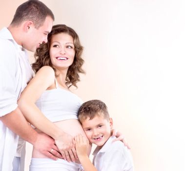 Happy Family Expecting Baby. Kid Listening Pregnant Belly