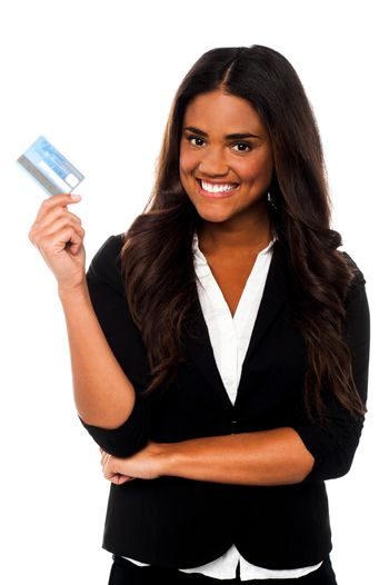 Attractive corporate lady displaying credit card
