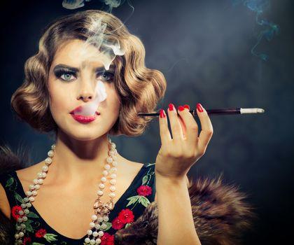 Smoking Retro Woman Portrait. Beauty Girl with Mouthpiece