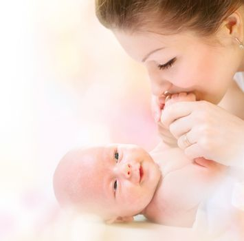 Newborn Baby. Happy Mother and Baby kissing and hugging