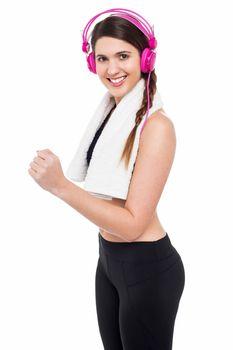 Woman enjoying music while jogging