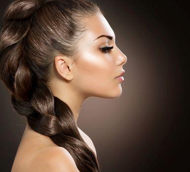Hair Braid. Beautiful Woman with Healthy Long Hair