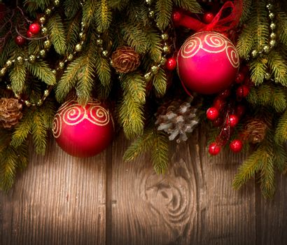 Christmas Tree and Decorations Over Wooden Background