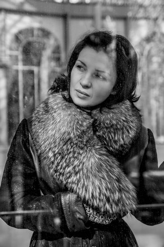 Vintage.Beautiful woman in winter.Beauty Fashion Model Girl in a Fur Hat. Russian Stylish young.Portrait.