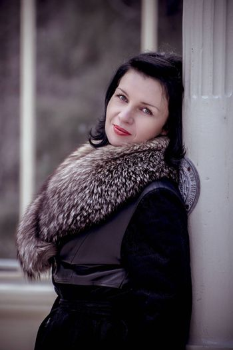 Dark angel.Beautiful woman in winter.Beauty Fashion Model Girl in a Fur Hat. Russian Stylish young.Portrait.