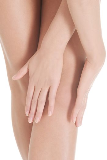 Close up on beautiful smooth knees with hands.