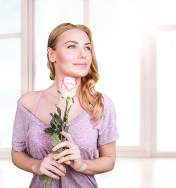 Gentle woman with rose