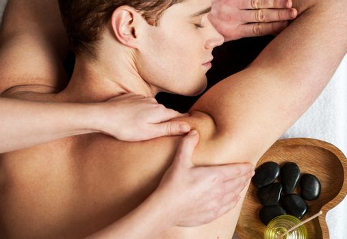 Spa hot stone massage preparation