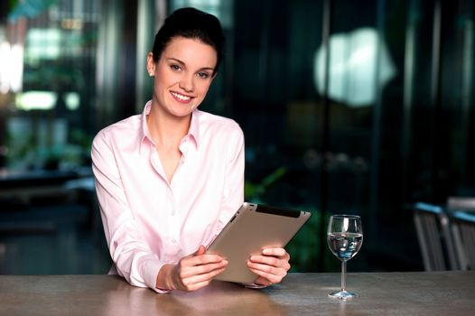 Corporate lady browsing on tablet pc