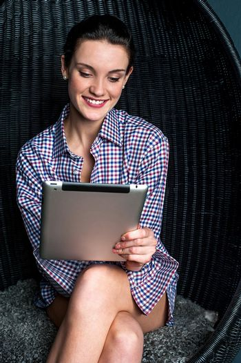 Sexy woman browsing on touch pad device