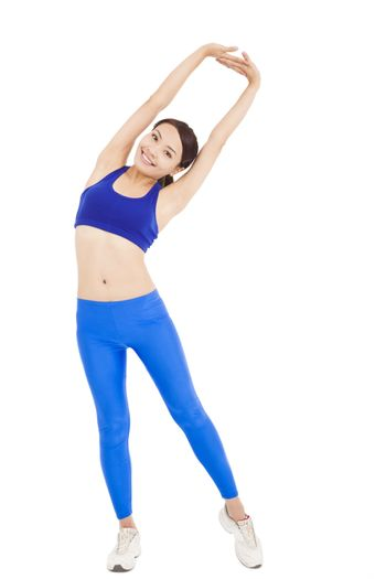 smiling  woman stretching and warming up for a workout