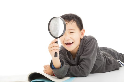 happy kid with magnifying glass and book