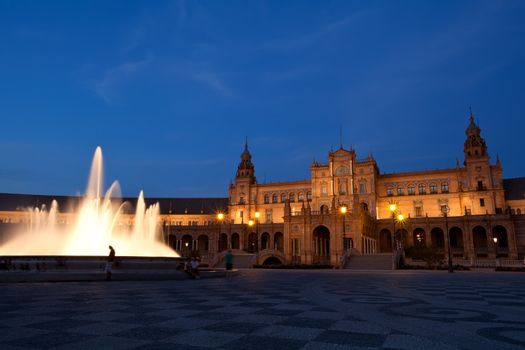 fountain by Plaza de Espana in Seville at night