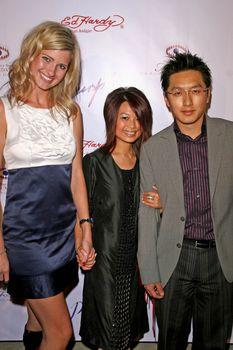 Ashley King with the Dan Sara Designers Serena Guan and Gino Guan /ImageCollect