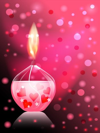 beautiful glass candle on pink background with a bright flame