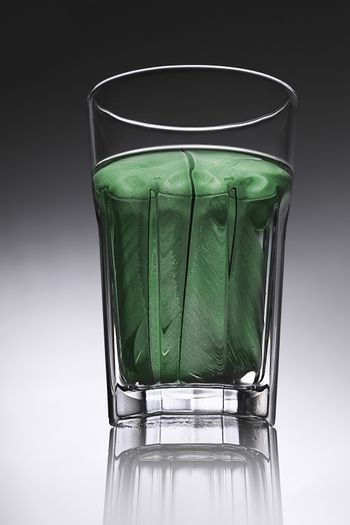 simple water-glass with structured water in green