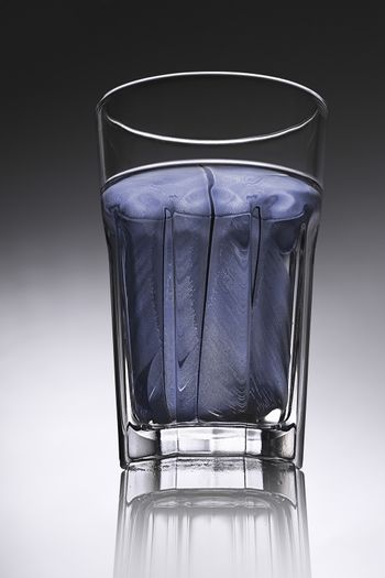 simple water-glass with structured water in blue