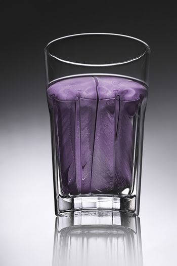 simple water-glass with structured water in purple