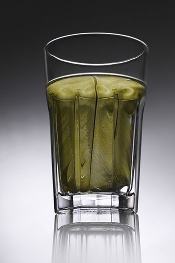 simple water-glass with structured water in yellow