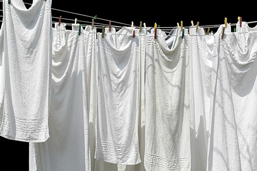 white towels hanging on clothesline isolated  on black