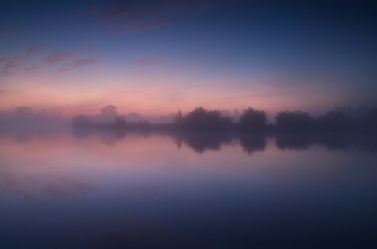 tranquil misty sunrise on lake