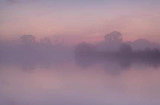 tranquil misty sunrise over lake