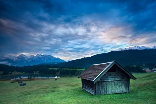 wooden hut by Geroldsee lake during sunrise