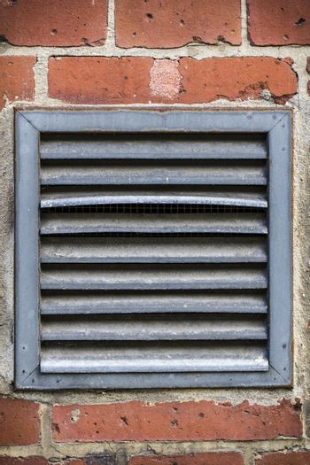 outdoor ventilation on a red brickwall