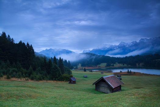 wooden hut on meadow by Geroldsee lake