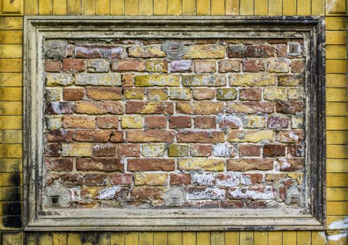 Old brick wall pattern closeup with stucco frame